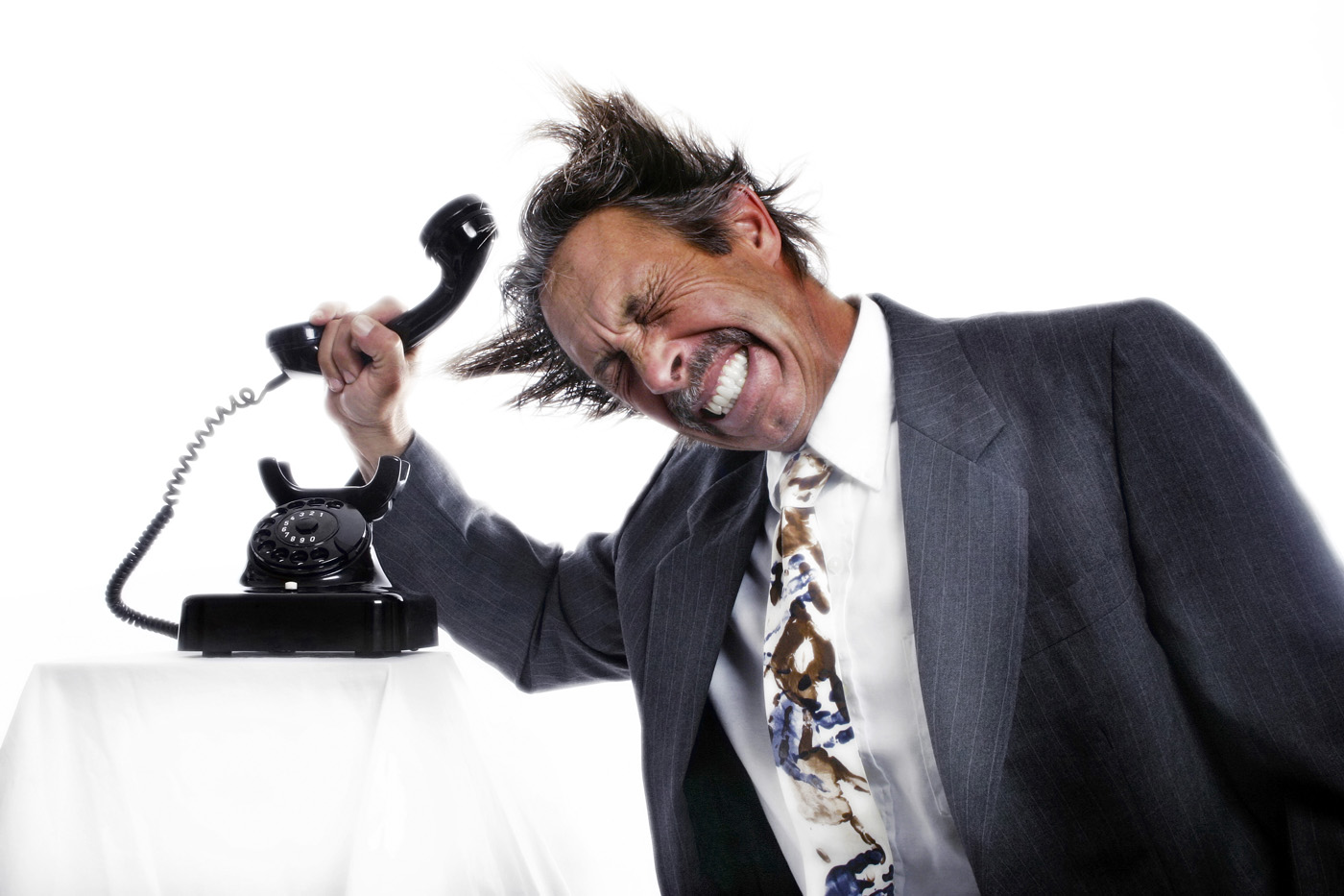 Businessman-knocking-his-head-with-a-phone-receiver-1